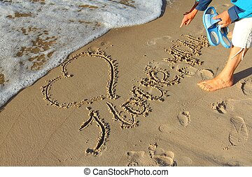 Symbol of love - Drawing in the sand on the beach symbol of ...