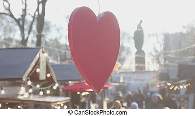 symbol of love red heart spins at a city fair, vacation