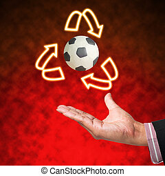 Symbol of plasticine football with business hand  on abstract background