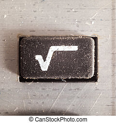 Symbol Square Root - Old dirty and dusty rubberized button...