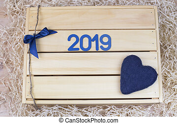 Symbol with number 2019 and a heart on a wooden box