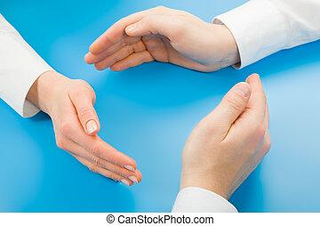 Symbolic circle - Human hands making symbolic circle on a...
