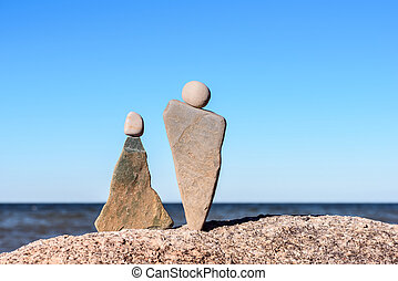 Symbolic figurines of stones - Symbolic figurines of man and...