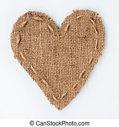 Symbolic heart of burlap lies on a white background, with...