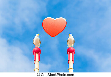 Symbolically, Seagull with red heart. - Two large seagull...