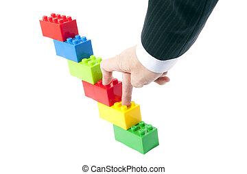 symbolisch, konstruktion spielt, und, a, geschäftsmann, hand.