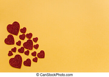 Symbols in the form of hearts on a red background.