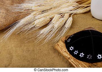 Symbols of jewish holiday Shavuot torah and shofar wooden background.