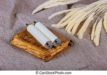 Symbols of jewish holiday torah wheat shavuot kosher food background.