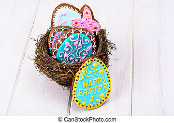 Symbols of the holiday Easter-nest, eggs, cookies