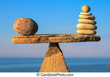 Balance of pebbles on the top of triangle stone
