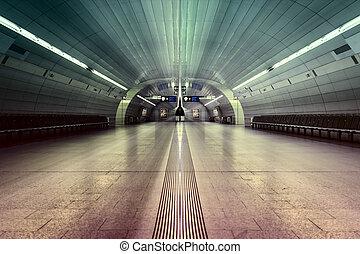 symmetric underground station hall with colored illumination