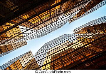 Symmetrical upwards shot of high-rise modern office block, ...