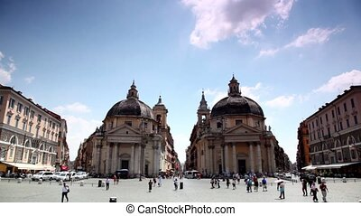 Symmetrically arranged edifices of Santa Maria in Montesanto on  Piazza del Popolo