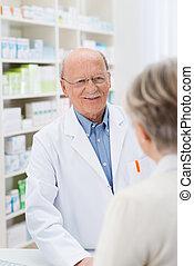 Sympathetic friendly male pharmacist