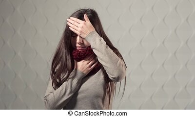 Symptoms of Illness - Ill woman in cherry scarf coughing and...