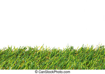 Synthetic grass in front of white background