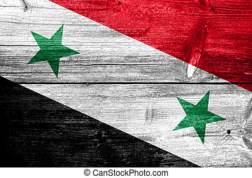 Syria Flag painted on old wood plank background