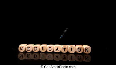Syringe falling and rolling over dice spelling medication in...
