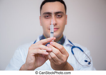 Syringe - medical injection in hand -Medicine plastic with holding doctor vaccination equipment - Health care in hospital.