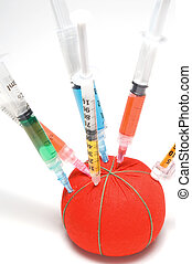 A batch of medical syringes in a pin cushion.