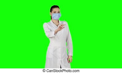 Syringe with a medicine in a hand. Green screen