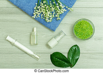 Syringe with eye cream, bottles with cream for face skin and aromatic oil