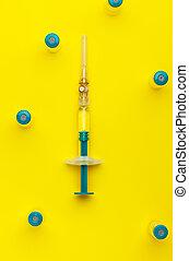 Syringe with several medical vials.