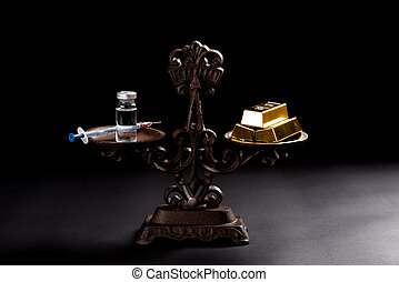 syringe with vaccine and gold bars on a balanced scale concept of expensive medicine