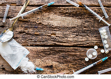 syringes, drugs and other accessories addict in the form of a circle with place for text on wooden background