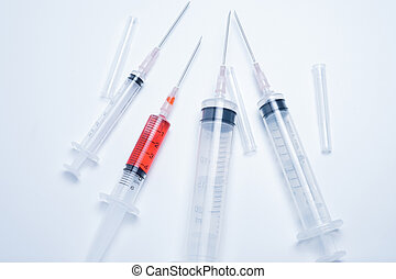 syringes with red vaccine on white background