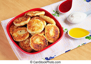 Syrniki. Cottage cheese pancakes. Fritters of cottage cheese, traditional dish Ukrainian and Russian cuisine.