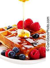 Syrup Pouring Over Waffles - A stream of golden Canadian ...