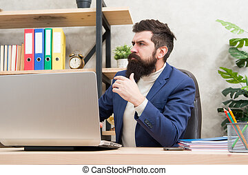 system administrator servicing server rack. configuration of computer systems and networks. Brutal man in business office. Mature man hipster use computer. Male boss working. sysadmin day 28 July