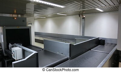 System of transportation and distribution of luggage of passengers at baggage carousel at airport.