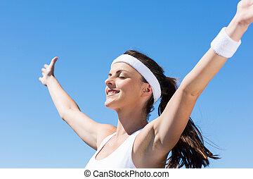 szczęśliwa kobieta, z, herb outstretched