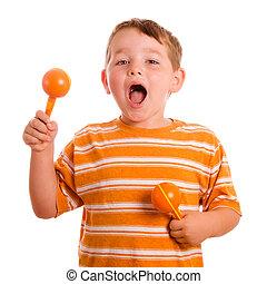 szczęśliwy, dziecko grające, maracas, i, znacząc, odizolowany, na białym