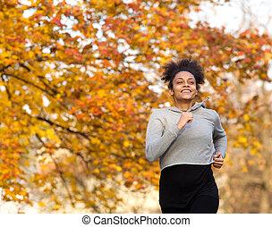 szczęśliwy, młoda kobieta, wyścigi, outdoors, w parku