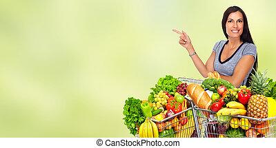 szczęśliwy, młoda kobieta, z, sklep spożywczy shopping, cart.