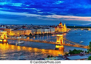 Szechenyi Chain Bridge and Parliament at dusk. Budapest,...