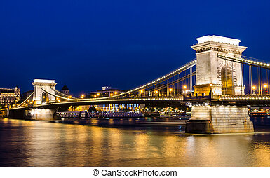 The Szechenyi Chain Bridge is a suspension bridge that spans the River Danube between Buda and Pest, the western and eastern sides of Budapest, the capital of Hungary. It was the first permanent bridge across the Danube in Budapest, and was opened in 1849.