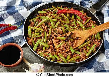Szechuan Stir Fried Green Beans with ground pork in a...