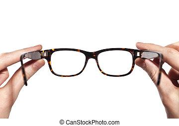 szemüveg, noha, horn-rimmed, alatt, emberi kezezés,...