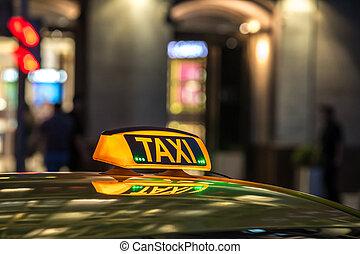 táxi amarelo, sinal, ligado, à noite, em, um, metrópole