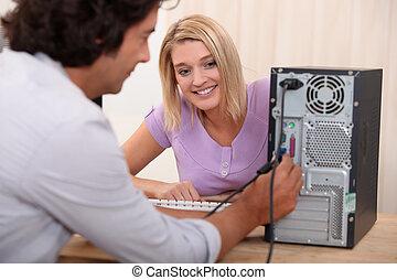 técnico, afixando, computador
