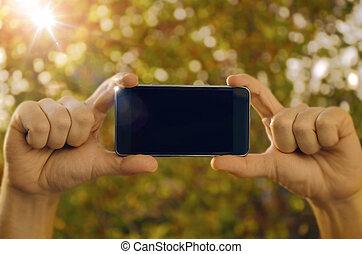 téléphone, tenue, intelligent, mains