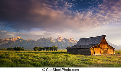 Iconic T. A. Moulton barn and Teton peaks at dawn in Grand Teton National Park, WY
