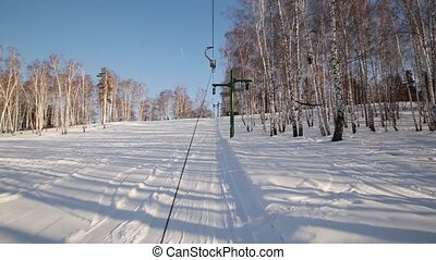 T-bar ski lift pull skiers to the top of the slope. lift for...