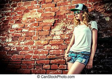 t-shirt style - Beautiful modern girl near the brickwall....