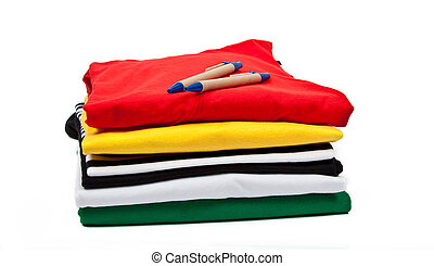 t shirts and pens - a stack of colorful t shirts and...